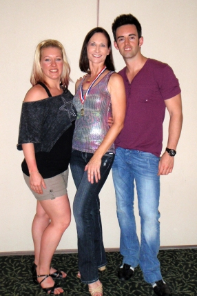 Rita receives 1st place award @ WCSwing Pro Intensive; pictured with WCS Champions Jordan Frisbee & Tatiana Mollman